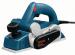 Цены на Bosch Рубанок Bosch GHO 26 - 82 0601594103 ОПИСАНИЕ Легкая,   удобная для работы одной рукой машина для осуществления всех строгальных работ по внутренней отделке. Комбинированная рукоятка для ведения и установки глубины строгания. Выброс стружки по выбору на